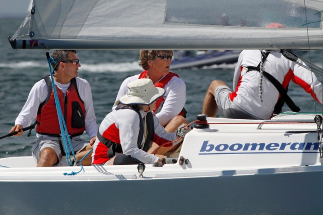 A team of 4 racing boats