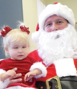 15 month old Lilly sitting in Santa's lap