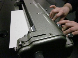 Close up of hands on a braillewriter