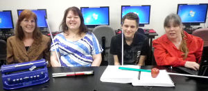 A photo of Penny with some of her students in the Lighthouse computer lab.