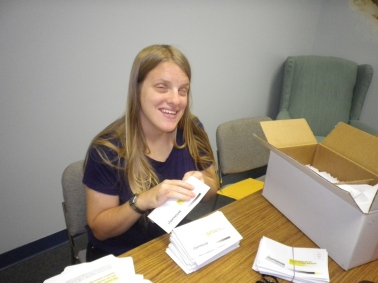 A female volunteer helps prepare a donor mailing.