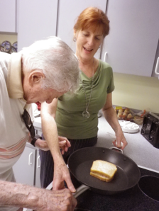 Donna teaches a client to make grill cheese safely
